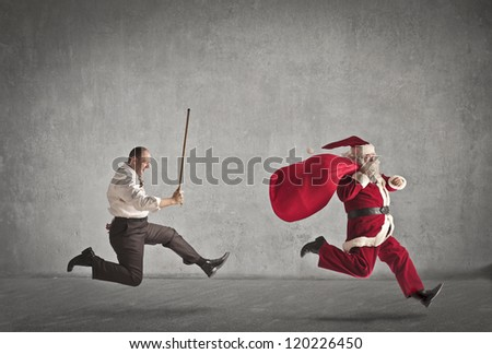 Santa Claus running away from a man who pursues him with a stick - stock photo