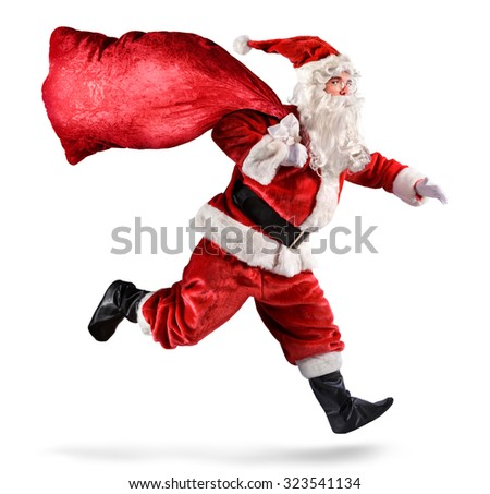 Santa Claus Running With A bag Of Gifts On A White Background  - stock photo