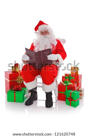 Santa Claus sat in a rocking chair surrounded by gift wrapped presents as he reads the Naught or Nice list, isolated on a white background.