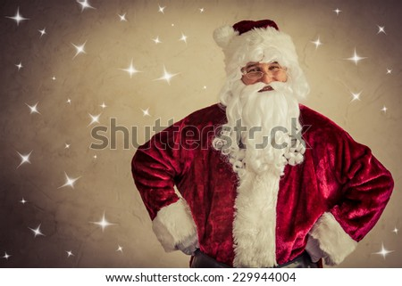 Santa Claus senior man against snow background. Xmas holiday concept - stock photo