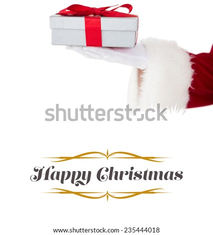 Santa claus showing gift with red ribbon against border - stock photo