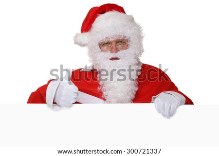 Santa Claus showing thumbs up on Christmas with empty banner and copyspace for your own text