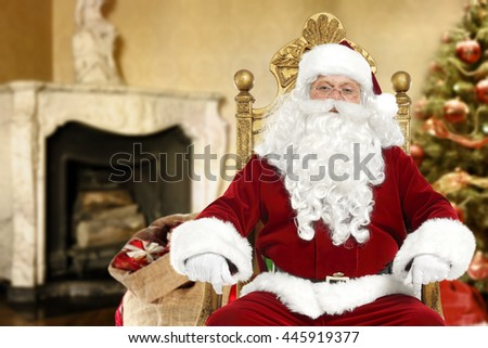 Santa Claus sits on a chair at home