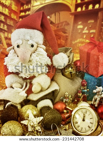 Santa Claus sitting among antique toys next to the alarm. Toning. Vintage postcards. Imitation of Vintage
