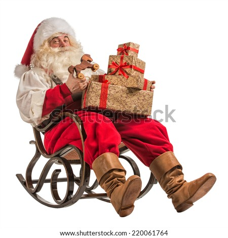 Santa Claus sitting in rocking chair with gifts isolated on white background - stock photo