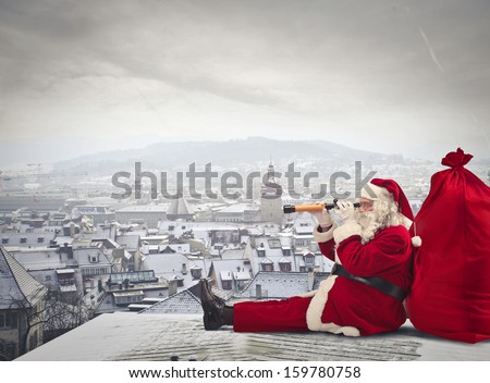 Santa Claus sitting over the city looking through spyglass - stock photo