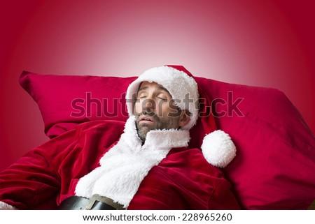 Santa Claus sleeping on his sack - stock photo