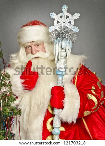 Santa Claus smiling on gray background - stock photo