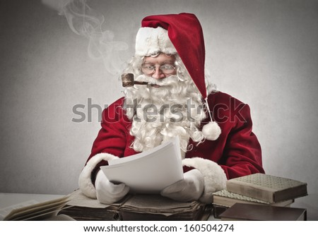 Santa Claus smoking a pipe and reads gifts requests - stock photo