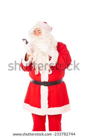 santa claus speaking at mobile phone, isolated on white - stock photo