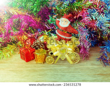 Santa Claus standing on golden rickshaw with gifts  and decorative for Christmas in soft style : filtered process