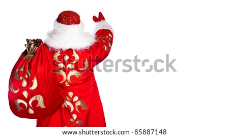 Santa Claus standing up on white background with his bag full of gifts. Photo from behind - stock photo