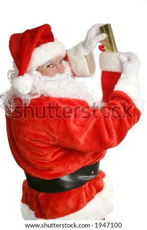 Santa Claus stuffing a Christmas stocking.  Focus on Santa's face.  Isolated on white. - stock photo
