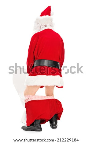 Santa Claus taking a piss in a toilet isolated on white background, rear view - stock photo