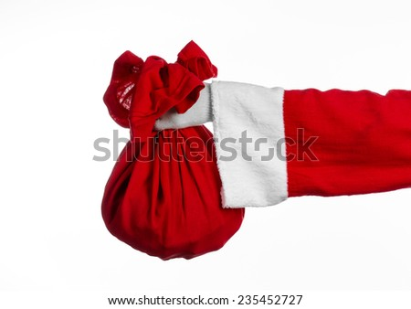 Santa Claus theme: Santa holding a big red sack with gifts on a white background