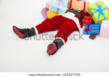 santa claus too tired to lie on floor with many gift boxes over white background - stock photo
