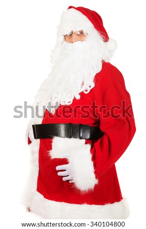 Santa Claus touching his fat belly - stock photo