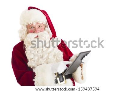 Santa Claus using digital tablet - stock photo