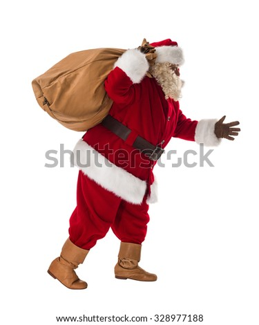 Santa Claus walking with his big bag Full-Length Portrait - stock photo