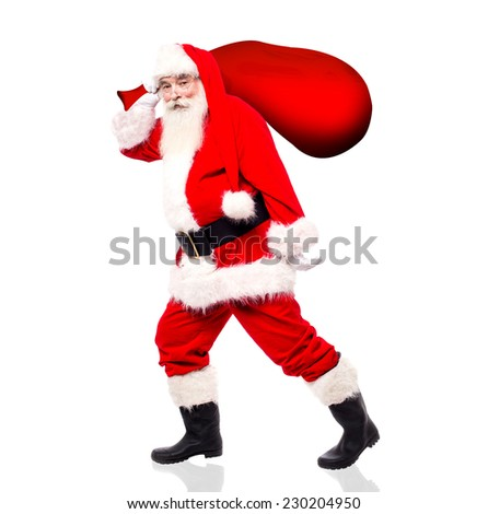 Santa-claus walking with his gift bag to distribute gifts - stock photo