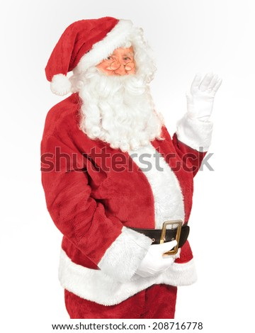 Santa Claus waving his hand on a white background - stock photo