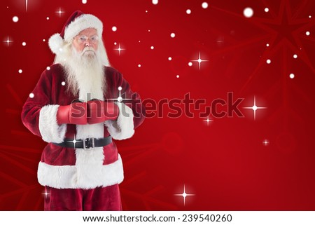 Santa Claus wears boxing gloves against red snowflake background - stock photo