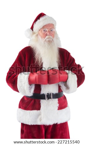 Santa Claus wears boxing gloves on white background - stock photo