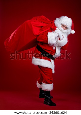 Santa Claus with a bag of gifts - stock photo