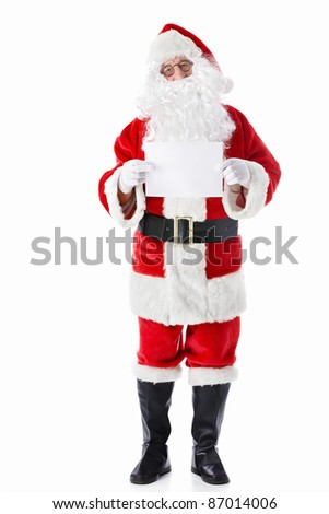 Santa Claus with a blank sheet of white - stock photo