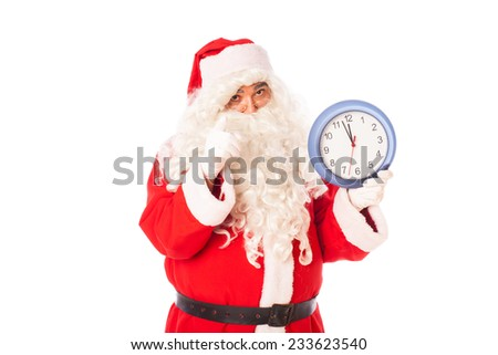 santa claus with a real clock in hands showing almost midnight, isolated on white background  - stock photo