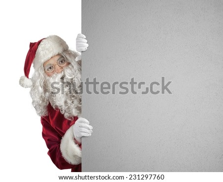 Santa Claus with a white xmas poster - stock photo