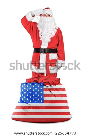 Santa claus with american sack salutes over white background - stock photo