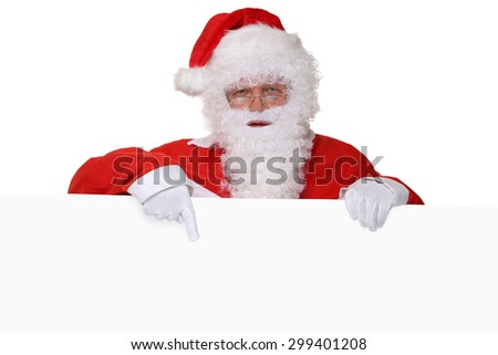 Santa Claus with beard pointing on Christmas at empty banner with copyspace for your own text