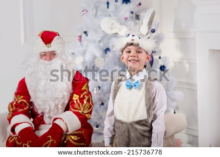 Santa Claus with children near the Christmas tree - stock photo