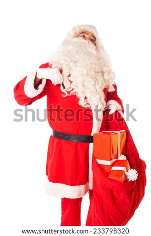 santa claus with credit card and sack of gifts in hand, isolated - stock photo