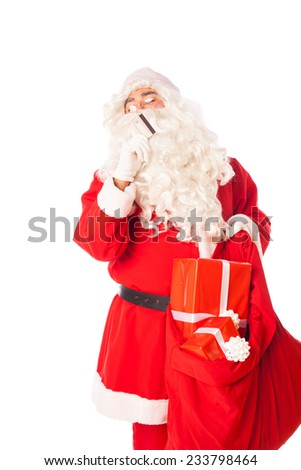 santa claus with credit card and sack of gifts thinking at his shopping, isolated  - stock photo