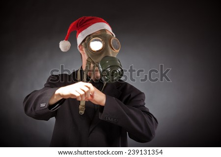 santa claus with gas mask in studio - stock photo