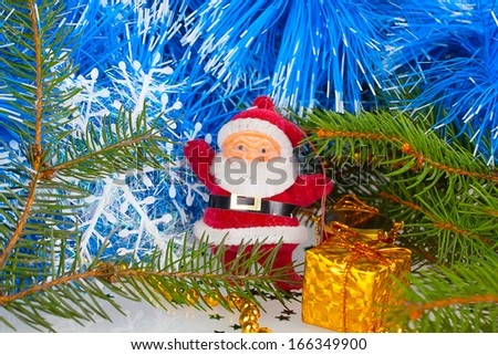 Santa Claus with gift under the Christmas tree