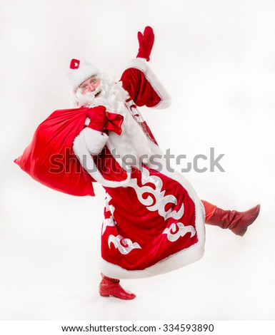 Santa Claus with gifts on white background. Isolated