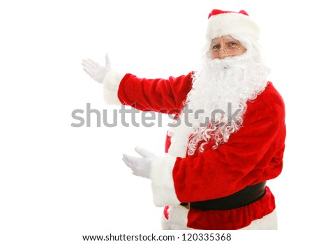 Santa Claus with his arms out in a presenting gesture.  Isolated design element. - stock photo