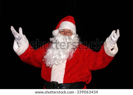 Santa Claus with his arms raised - stock photo
