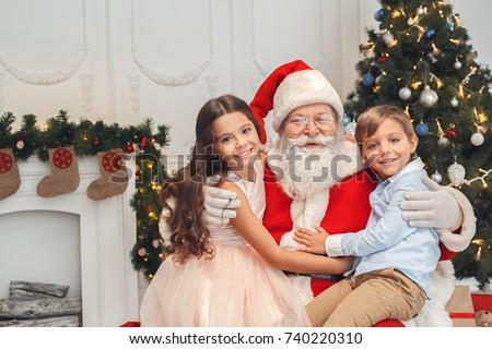 santa claus with kids indoors christmas celebration concept - Santa Claus Kids