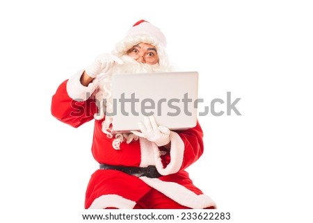 santa claus with laptop in hands shopping and browsing online, isolated on white