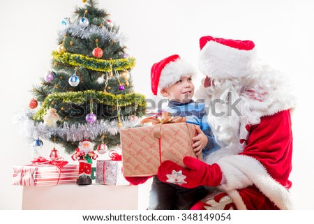 Santa Claus with little boy on white background.