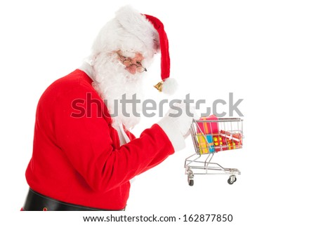 Santa Claus with little shopping cart gifts in recession time - stock photo