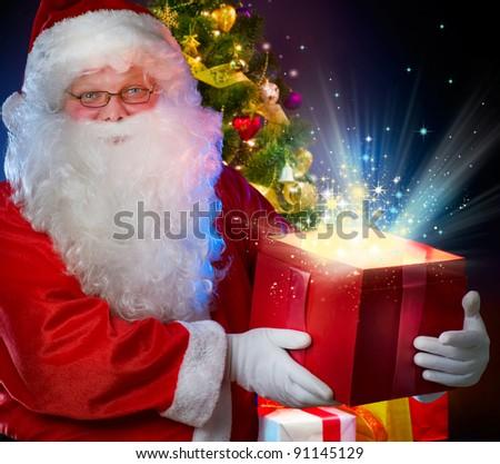 Santa Claus with Magic Gift - stock photo