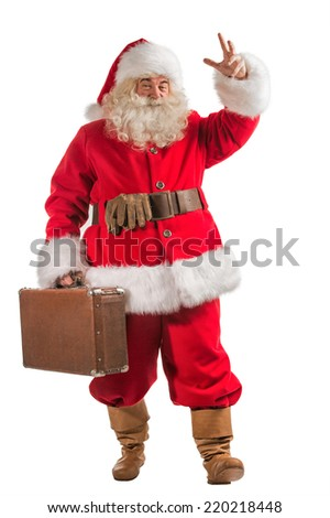 Santa Claus with old leather suitcase isolated on white background. Travel concept or postal delivery service. Full length portrait - stock photo