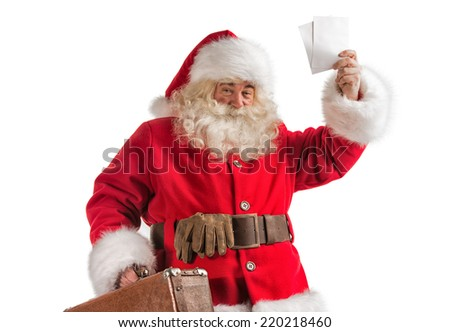 Santa Claus with old leather suitcase isolated on white background. Travel concept or postal delivery service.