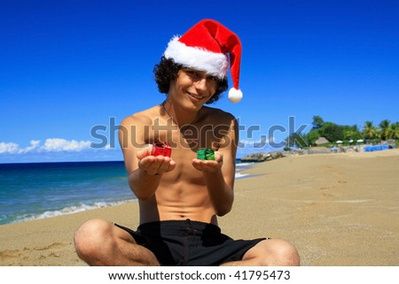 Santa Claus with present boxes on beach