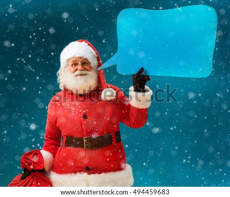 Santa Claus with sack of gifts showing sign speech bubble banner, looking happy excited. Happy Santa Claus on blue background. Merry Christmas & New Year's Eve concept.